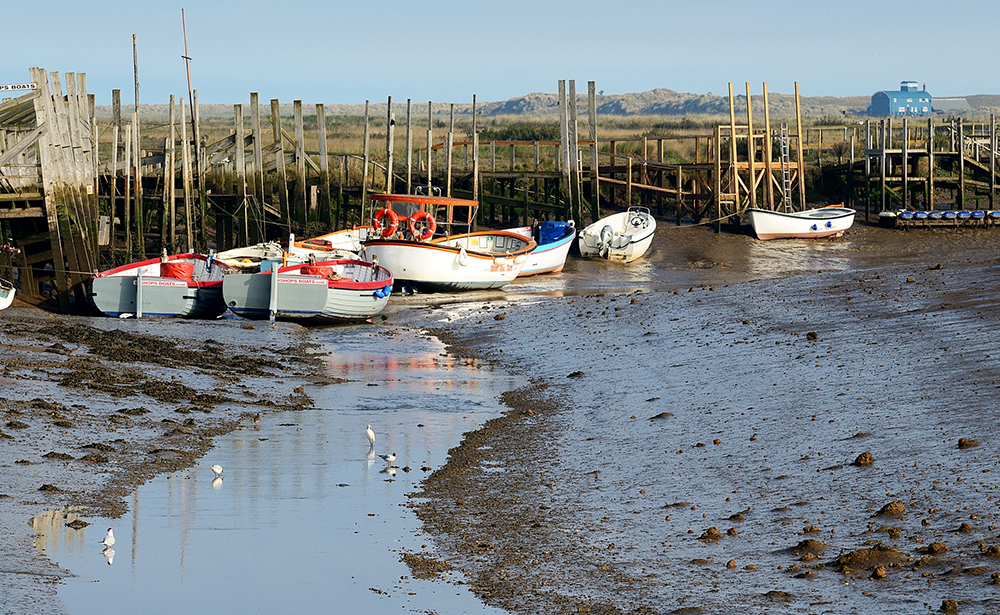Bishop's Boats in the creek at low water morston s